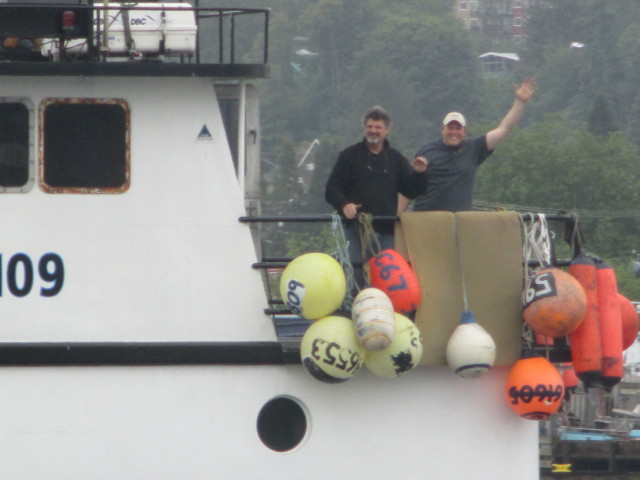 F/V Cornelia Marie, Capt. Casey & Capt. Jack all smiles, Ship Canal Underway Ballard Bridge, a wet NW June Morning!